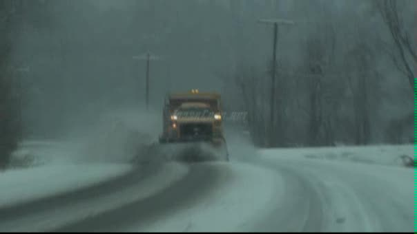 Snow Plow Takes Car on Icy Road