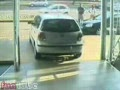 Crazy Showroom Car Driver Caught On Security Camera